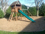 After Jim Bob's Lawn Care Installed Playmate® Play Area Wood Chips®